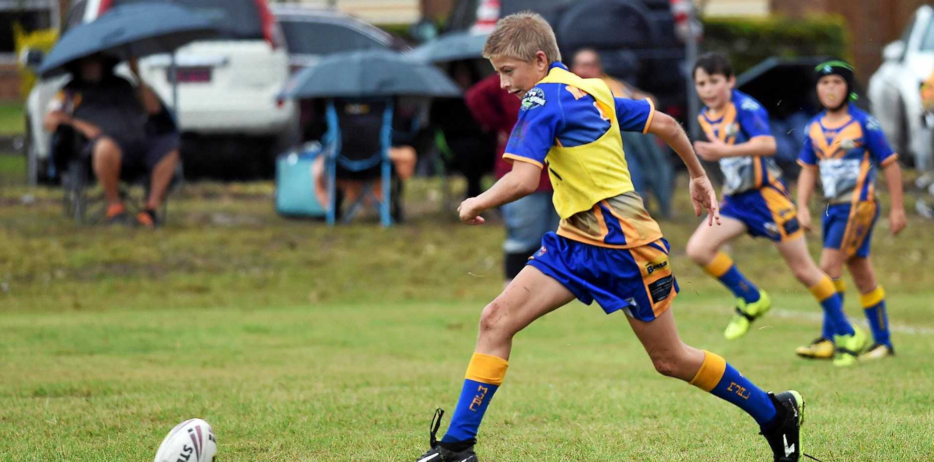 Junior Rugby League - u12 Murgon Mustangs (Blue) v Hervey Bay Red - Chase Kenday grubbers the ball in to space.
