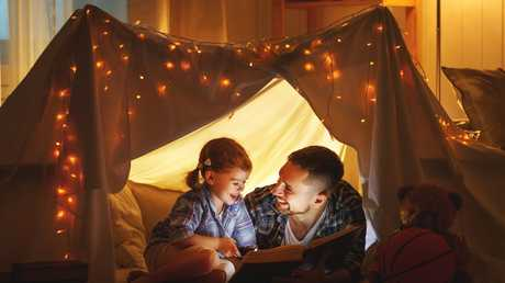 Reading can be a great opportunity to reconnect with your kids. Picture: iStock