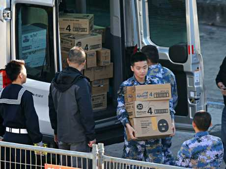 Military personnel unload boxes of baby formula and face masks on Thursday. Photographer: Adam Yip