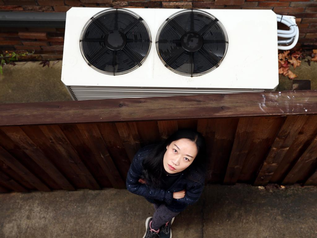 Nicole Li and her husband Neil are not happy with their neighbour's air conditioning unit and have complained to police and council about it. Picture: Sam Ruttyn