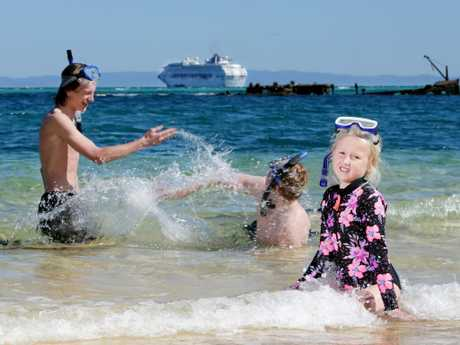 Couper McMullen-Hansen (left), 17, from Moss Vale, Cody Gray, 18, of Tallong, and Addyson Gray, 10, of Shellharbour, visit Tangalooma on Moreton Island while on a Pacific Explorer cruise. Picture: Steve Pohlner/AAP