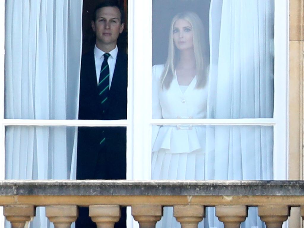 Ms Trump and Mr Kushner look out of the window at Buckingham Palace as the President and his wife arrive by helicopter for a ceremonial welcome. Picture: Chris Jackson/Getty Images)