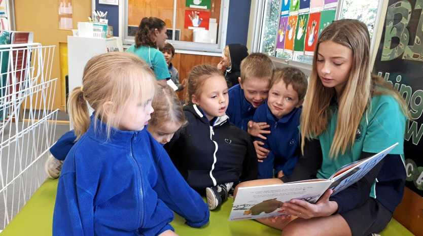A GOOD READ: High school English students visited Sunshine Beach State School to read to the Prep students.
