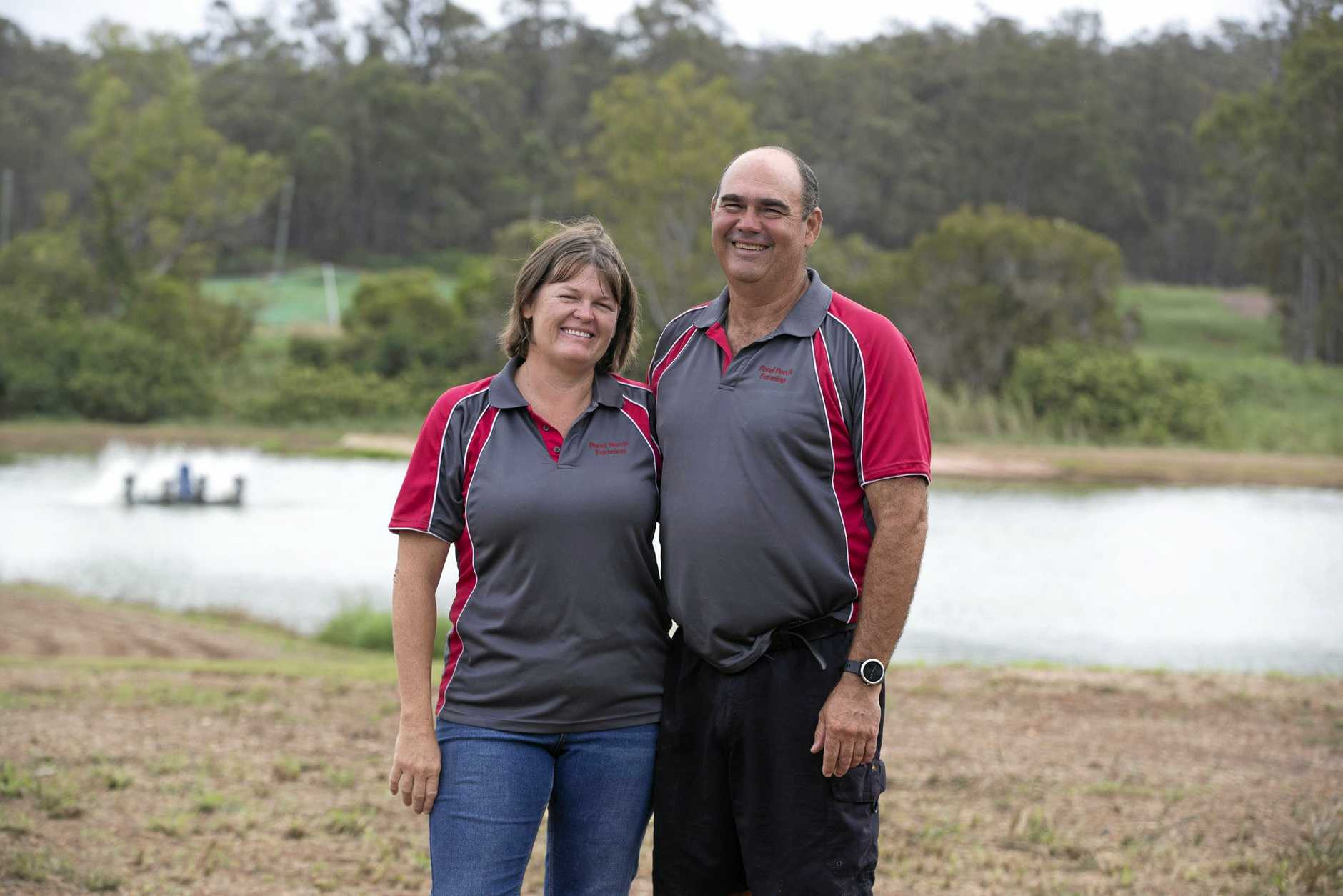 ACROSS THE POND: Childers aquaculture producers Lisa and Steven Volz invested in solar power to cut energy costs on their farm.