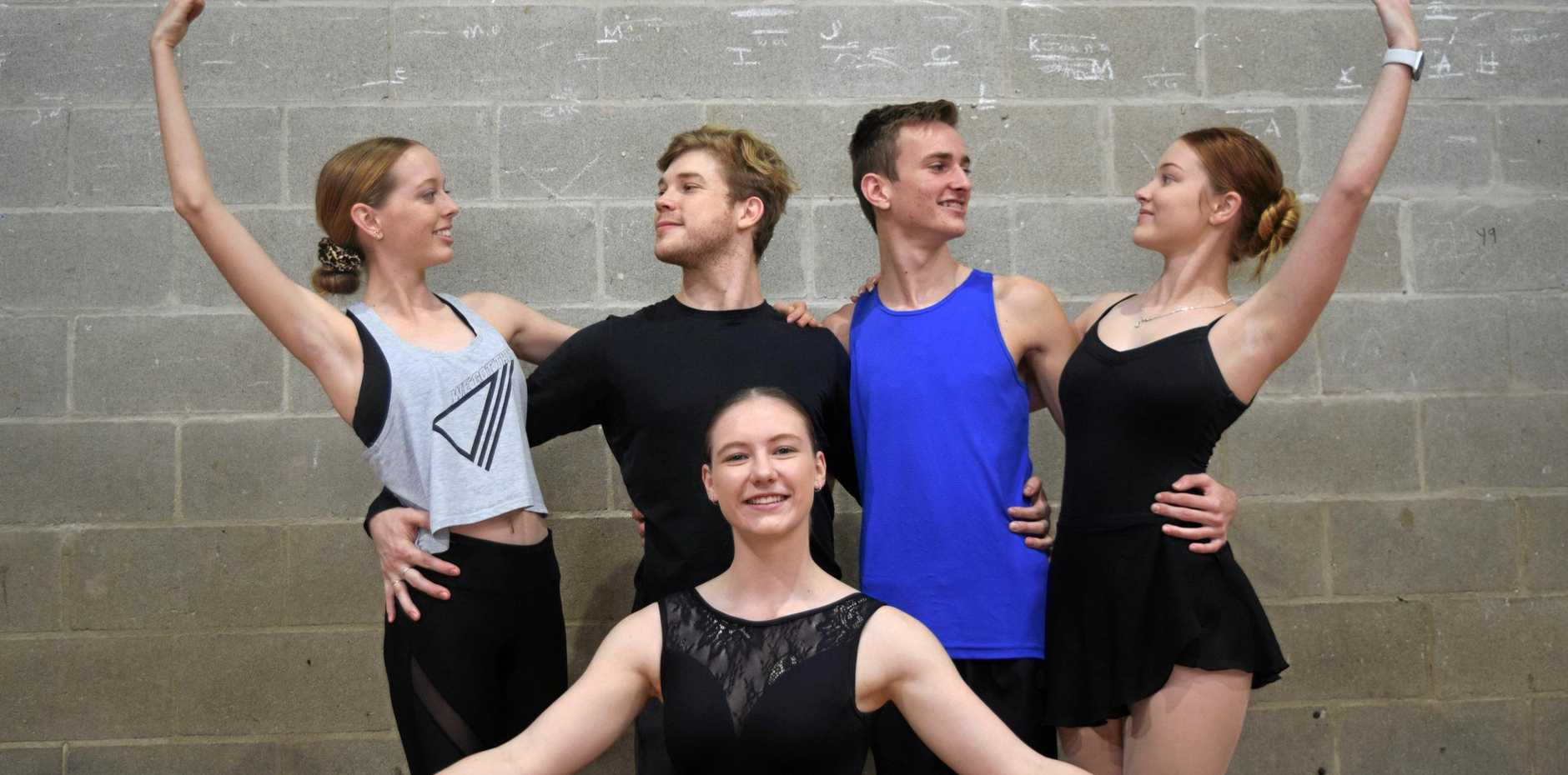 LIFE LESSONS: Queensland Ballet dancer Rian Thompson (second from left) has been passing on advice to help the development of Fame Talent School's Sophie Van Moolenbrouk, 15, Tiernan McCallum, 16, Lilly Hayes, 17, and Charlotte Meads, 15.