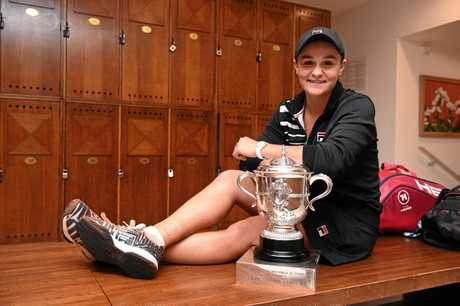 Ash Barty, with winner's trophy in her grasp, reflects on her French Open success at Goland Garros.
