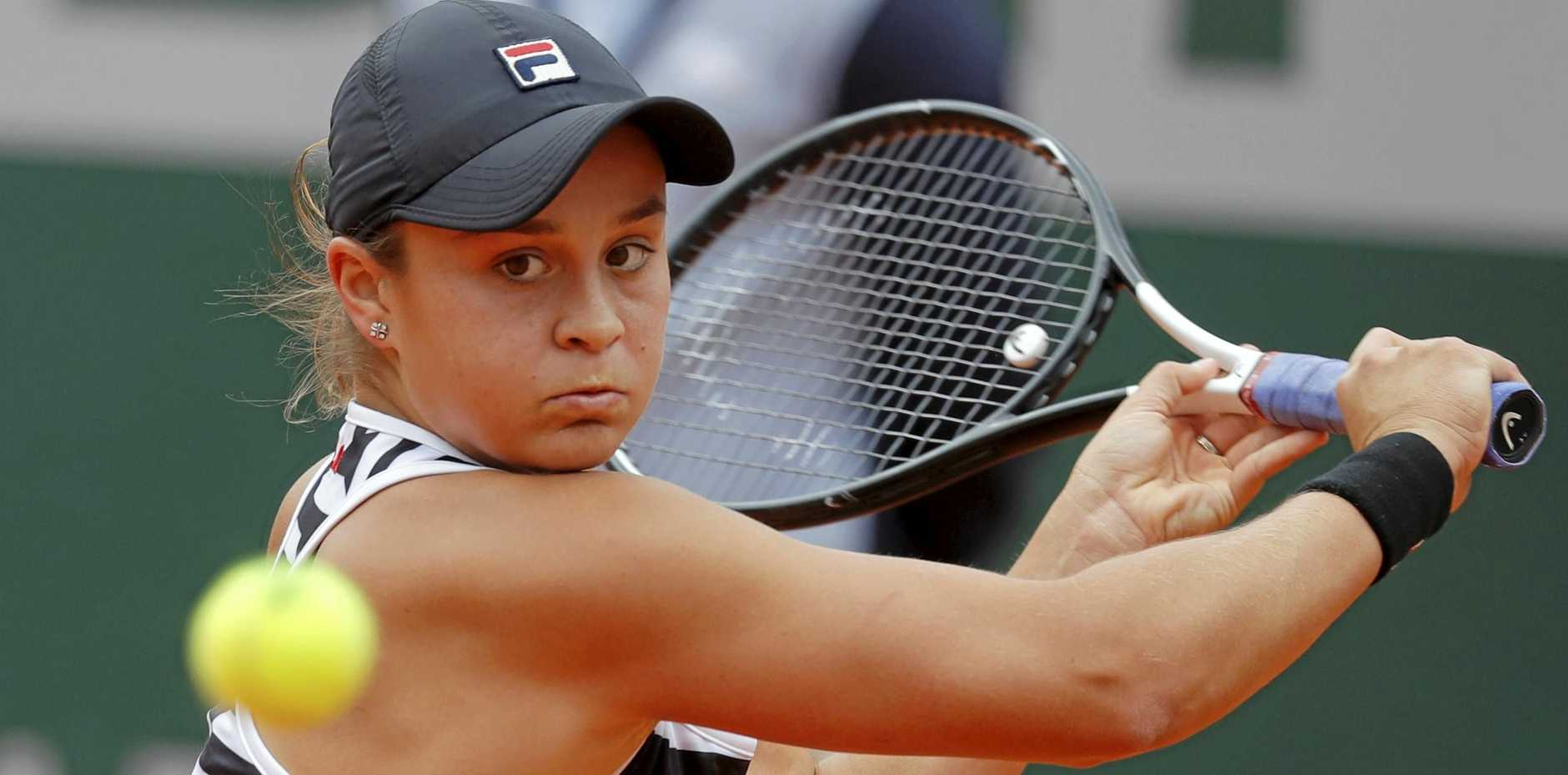 ON COURT: Australia's Ashleigh Barty plays a shot against Marketa Vondrousova of the Czech Republic during the women's final match of the French Open tennis tournament at Roland Garros in Paris.