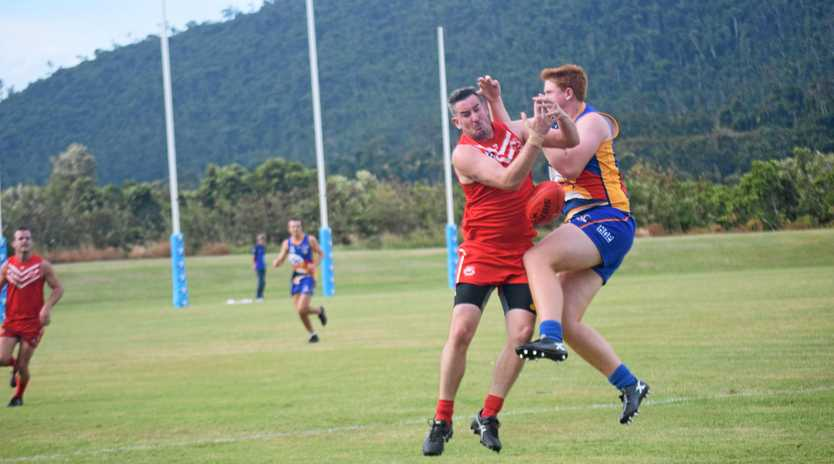Eastern Swans' Jarrod Van Hees and Whitsunday Sea Eagles' Casey Norder battle for the ball in Saturday's AFL Mackay's Allied Pickfords Cup match.