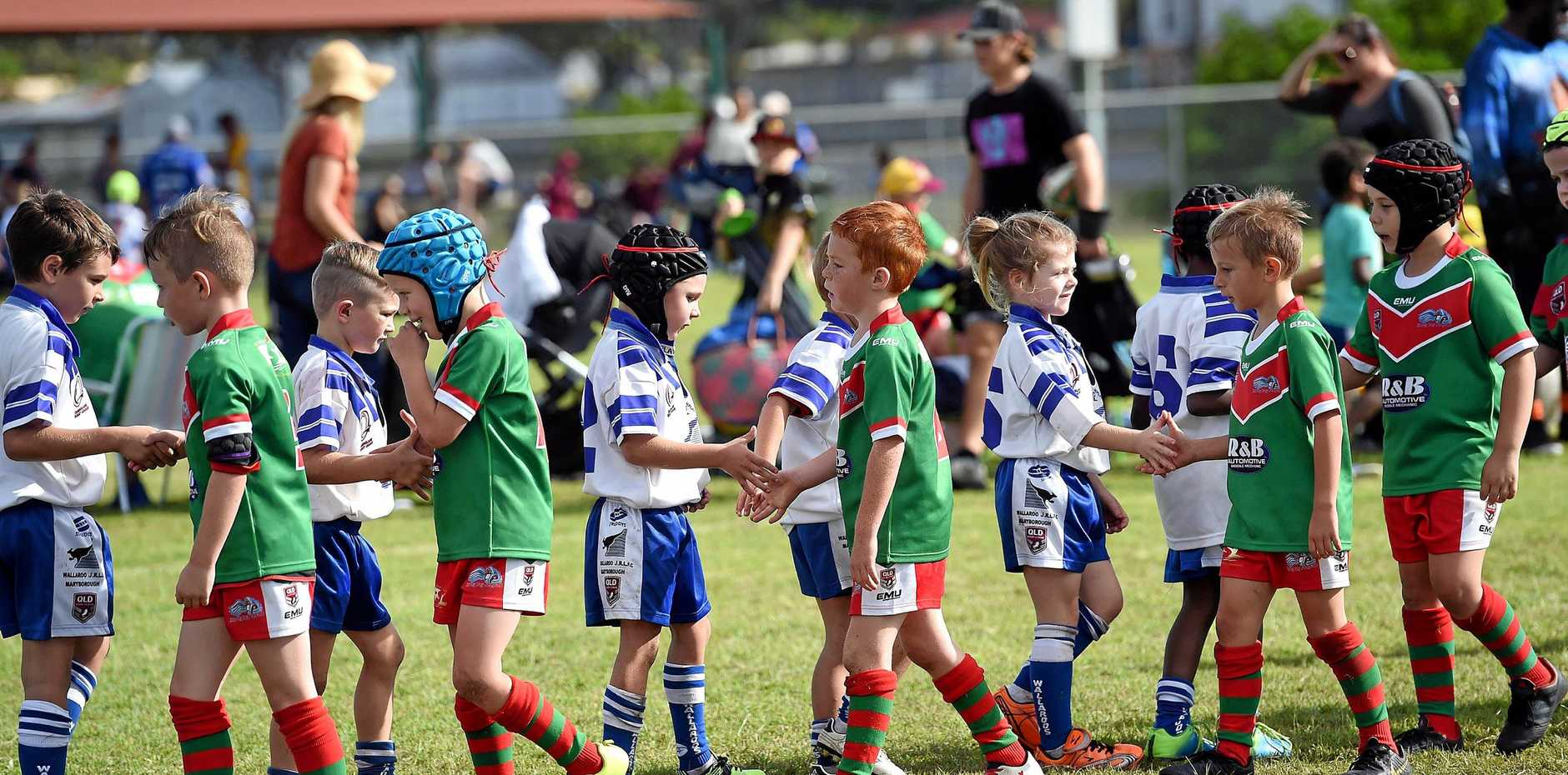 Junior Rugby League - u7 Hervey Bay (green) v Wallaroos White - Teams shaking hands at the end of the game.