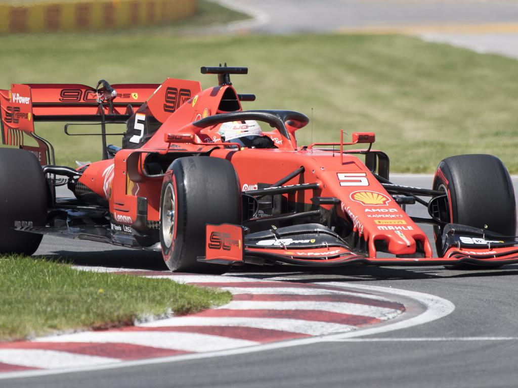 Ferrari's Sebastian Vettel drives through Senna corner during qualifying. Picture: Graham Hughes