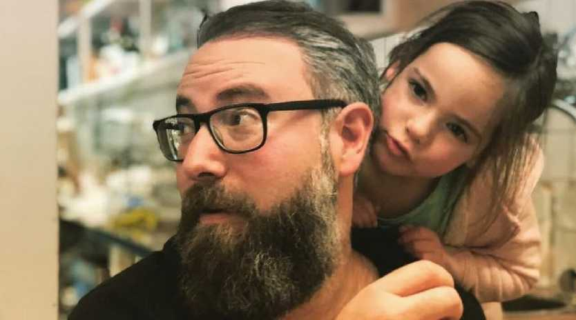 Darren Levin with one of his three daughters. Picture: Supplied