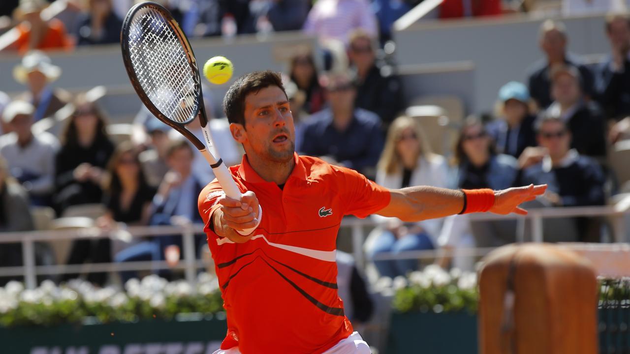 Novak Djokovic hits a return to Dominic Thiem. Picture: AP