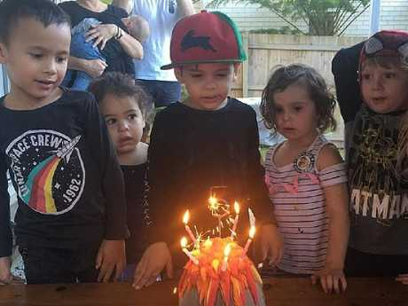 Greg Inglis' estranged wife Sally, posted an innocent of her son Nate (centre) standing before a birthday cake surrounded by friends before it was set upon by trolls