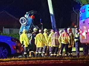 One critical, three injured after car overturns, hits pole