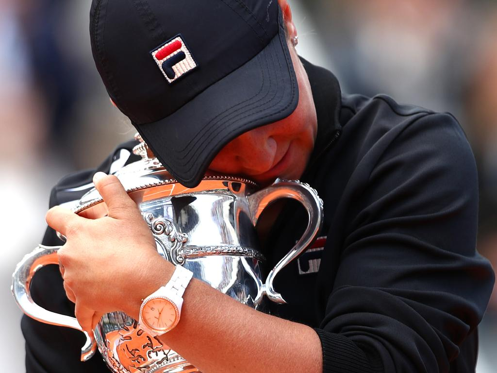 Ashleigh cuddles the French Open trophy after winning the final in Paris. Picture: Getty