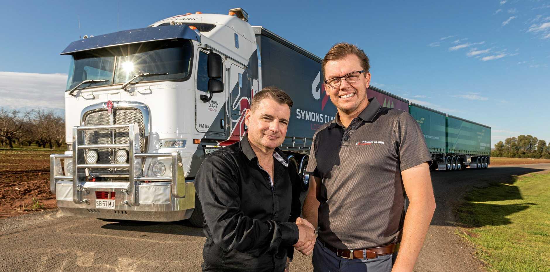 Virginia Farms' commercial business manager Ryan Densley, left, Jason Clark, general manager at Symons Clark Logistics.