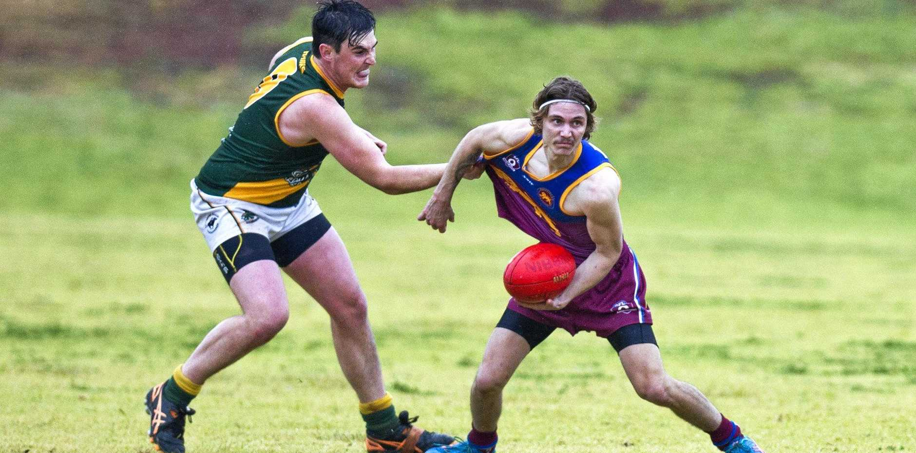 HOLDING ON: Goondiwindi Hawks player Joe Verney refuses to let Highfields' Callais Chicken get out of his grasp.