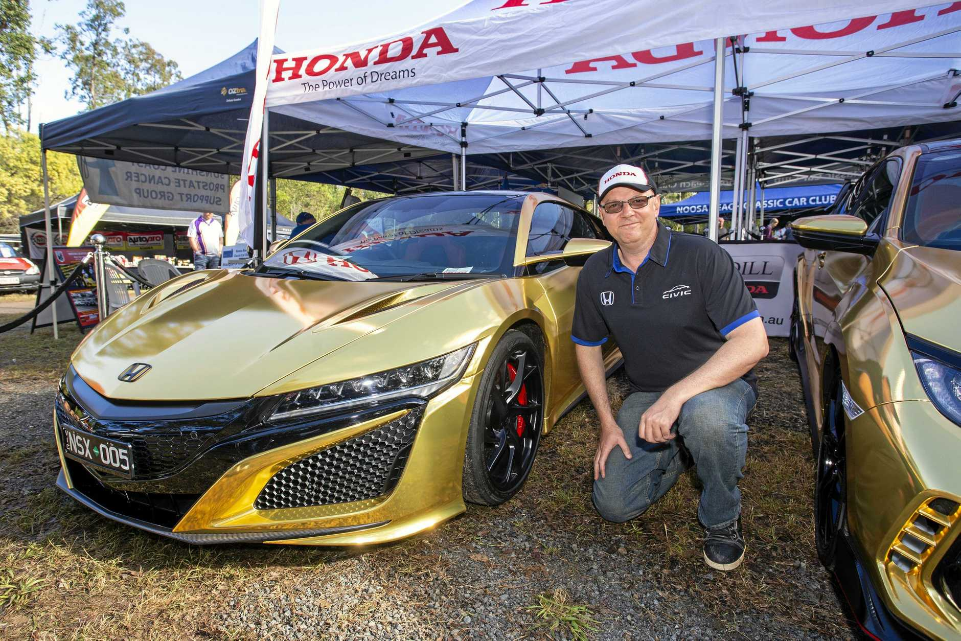 Graeme Steinohrt from Madill Honda Noosa with a gold-wrapped $420,000 Nissan NSX.