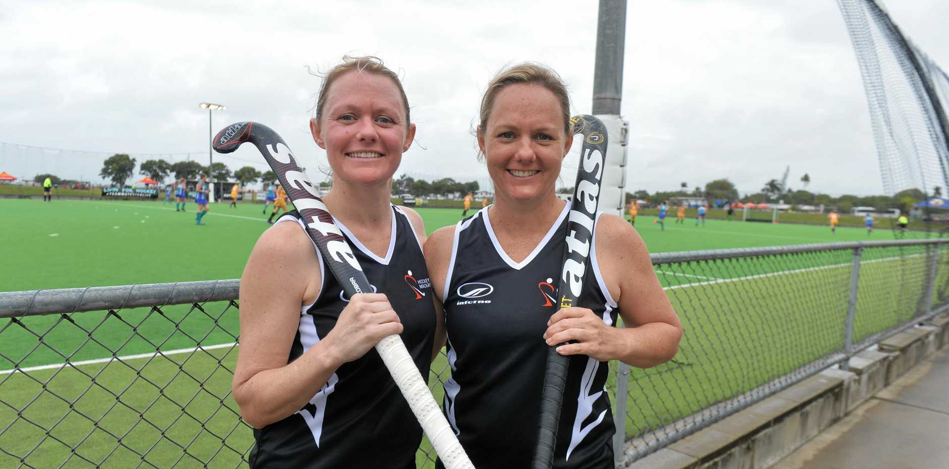 Sisters Rebecca Walpole, left, and Ellen Crawford have been playing hockey together since they were six. On Sunday they helped Mackay win the runners-up trophy at the Queensland Women's Masters Tournament.
