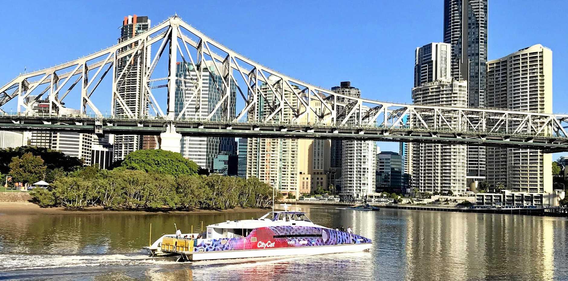 A CityCat cruises towards Brisbane's Story Bridge.