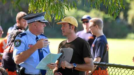 Theo Hayez's godfather Jean Philippe Pector talks to detective inspector Matt Kehoe in Byron Bay as the search continues for missing backpacker Theo Hayez.