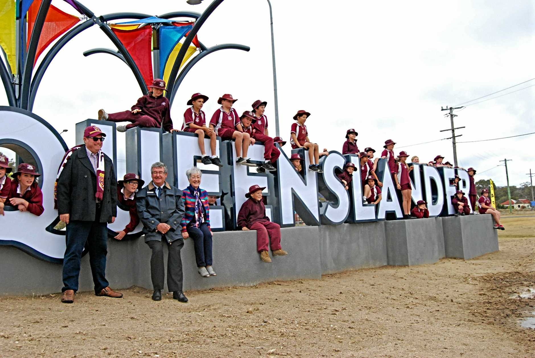 WHO WE ARE: A new sign has been installed on the border, welcoming people into the best state. The sign which reads Queenslander, is an ode to former local and State of Origin legend Billy Moore.