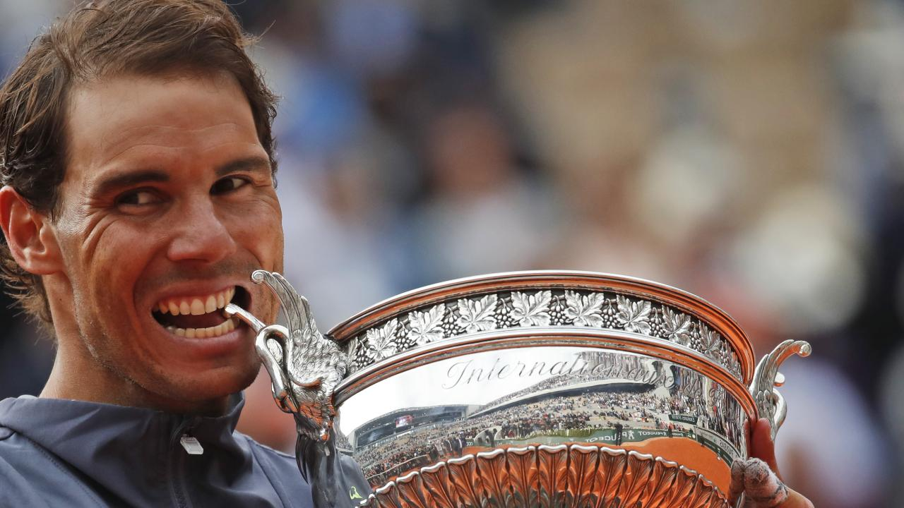 Spain's Rafael Nadal bites the trophy as he celebrates his record 12th French Open title after winning against Austria's Dominic Thiem. Picture: AP Photo