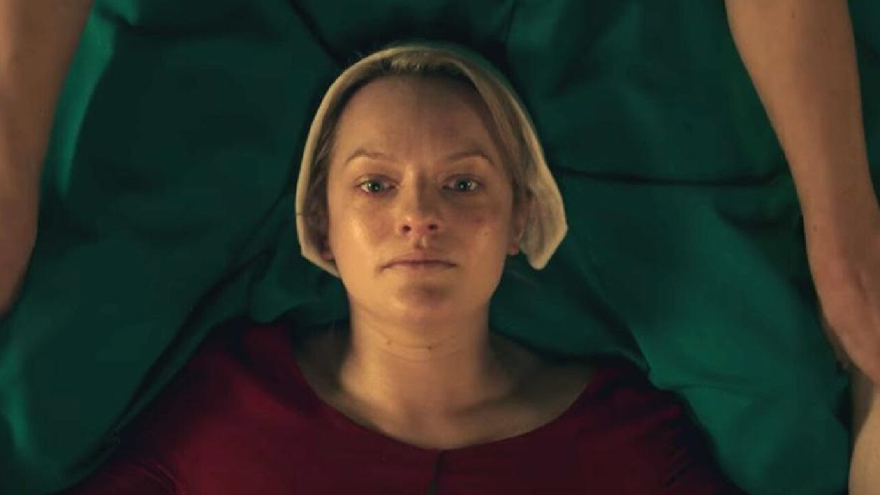 Elisabeth Moss in The Handmaid's Tale. Not a cute party theme, people!