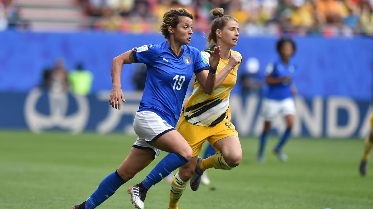 Elise Kellond-Knight (R) tracks a ball with Italy's Valentina Giacinti. Picture: Getty