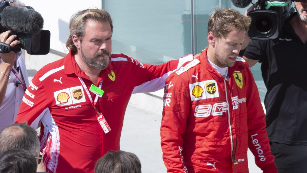 Second-place Ferrari driver Sebastian Vettel, front right, of Germany, walks over to the victory ceremony at the Formula One Canadian Grand Prix auto race Sunday, June 9, 2019, in Montreal. (Paul Chiasson/The Canadian Press via AP)