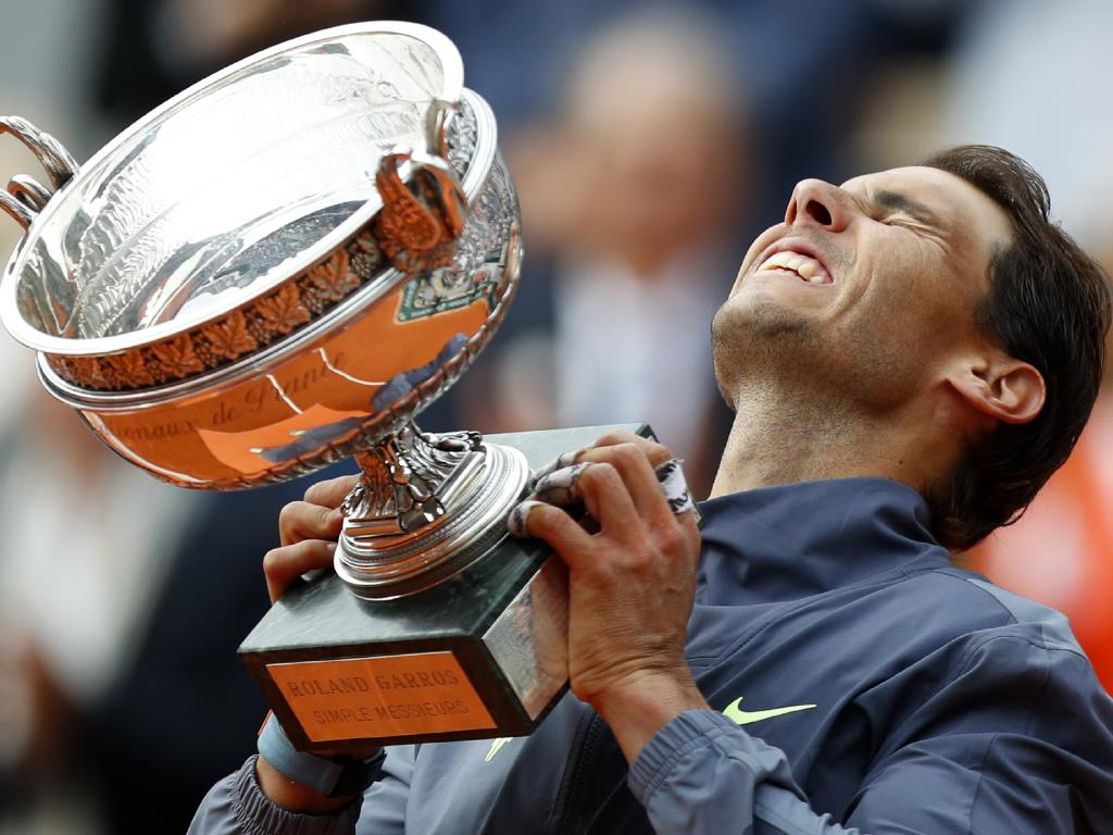 Spain's Rafael Nadal lifts the cup after defeating Austria's Dominic Thiem in their men's final match of the French Open tennis tournament. Picture: AP Photo/Pavel Golovkin