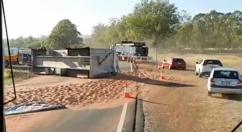 The truck rolled over on the Warrego Highway just after 5am.