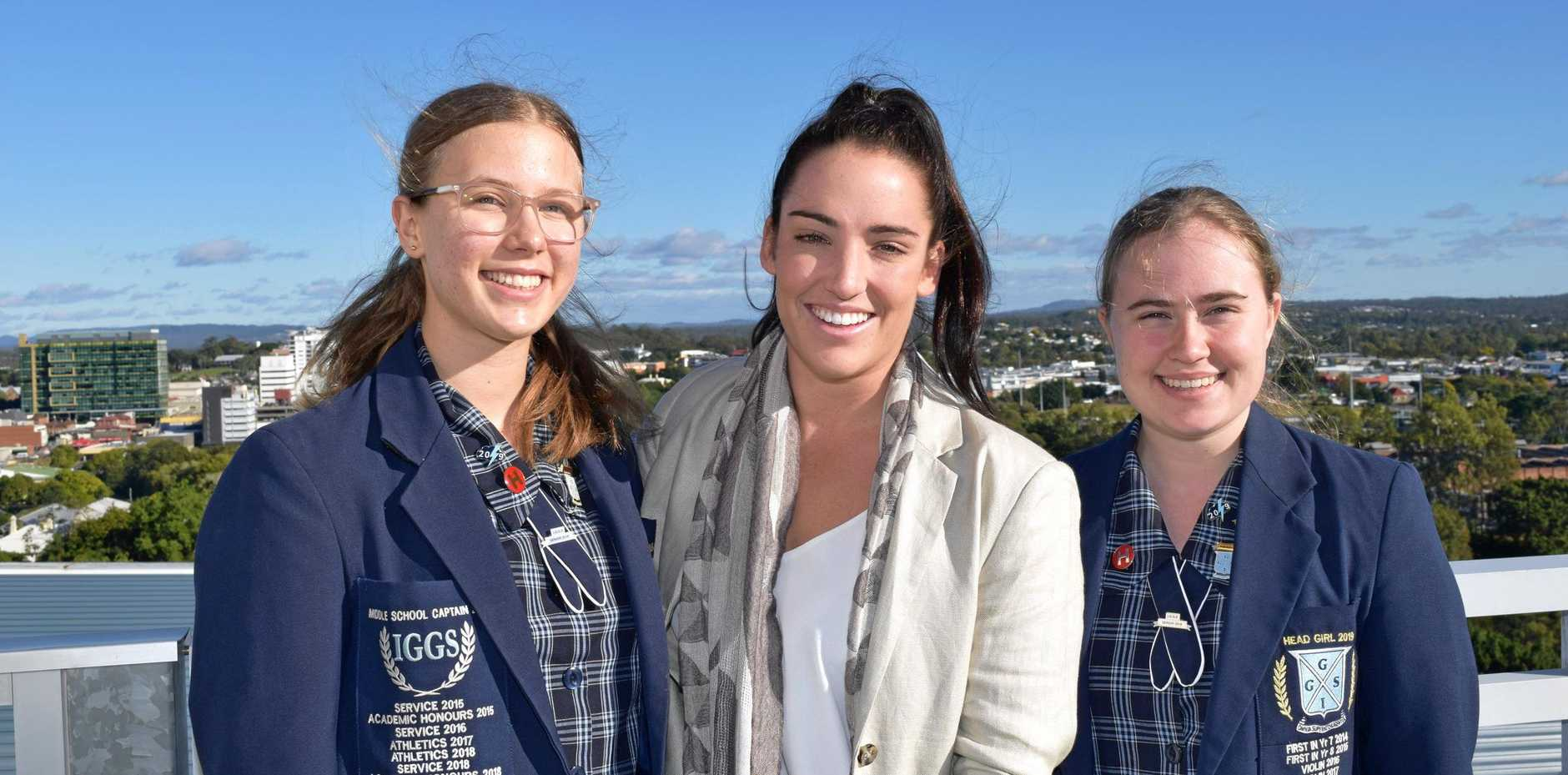 IGGS Head Girls Laura Carniel and Evangeline Sturges meet former student Jacqui Bell.
