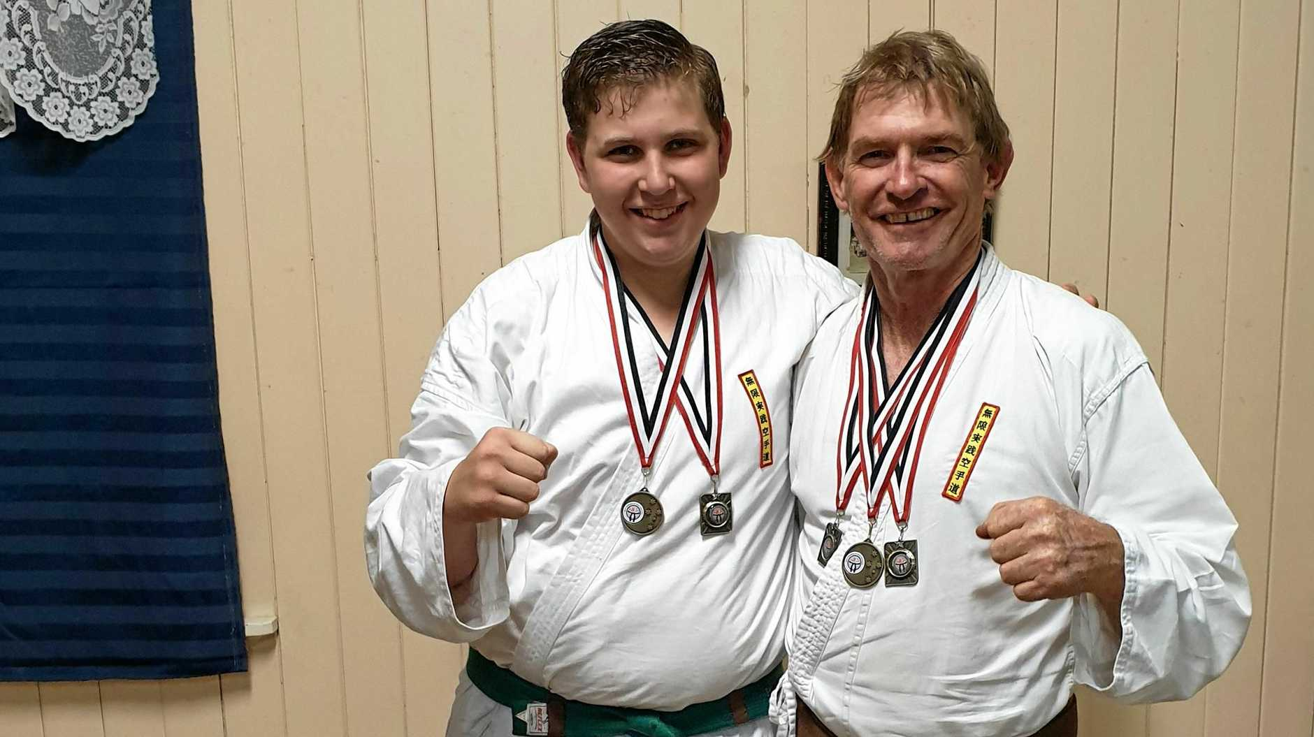 SPORT FOR ALL AGES: Mugen Gissen Karate Do Club senior students Isaac Waller and Owen Stewart compete at the Annual World Karate and Kickboxing Association's tournament held in Toowoomba on June 1.