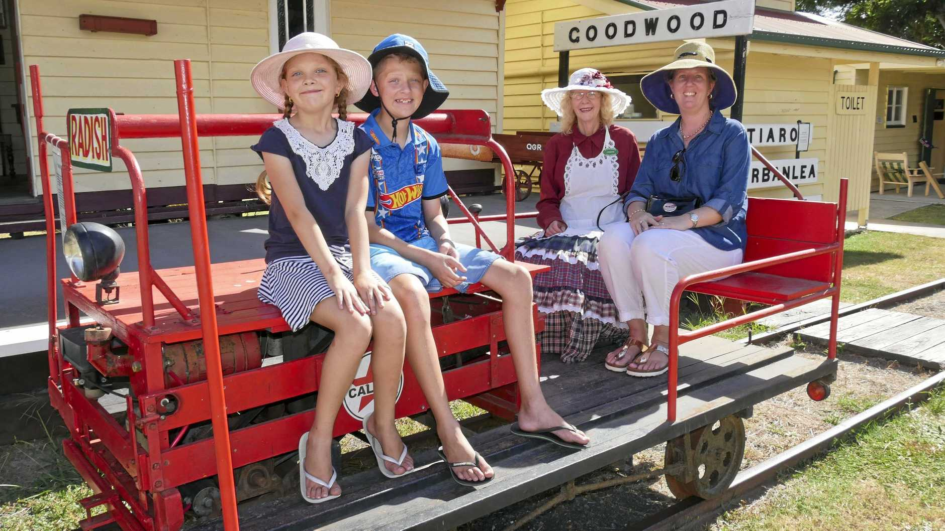 ALL SMILES: Brisbane visitors Emily, Lachlan and Renay Graham, have a chat with volunteer Lynette Andersen at the museum's Australia Day celebrations earlier this year.