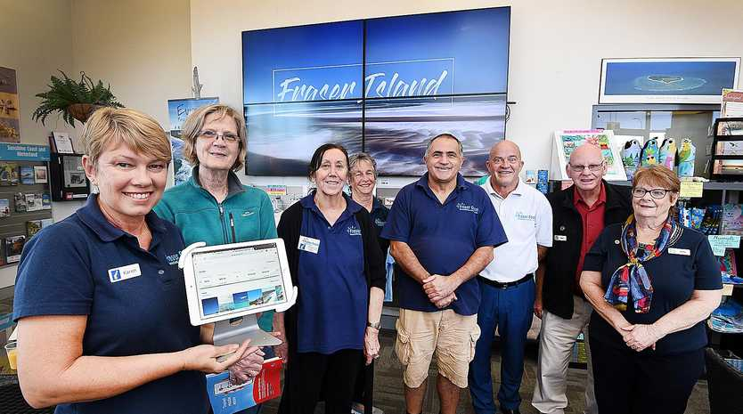 SHOWCASING SIGHTS: Karen Rasmussen, visitor Cheryl Mountford from Adelaide, Gillian Robertson, Muff Christensen, John Scicluna, Andrew Ellis and Vince and Gloria Chay in the newly renovated Hervey Bay Visitors Centre.