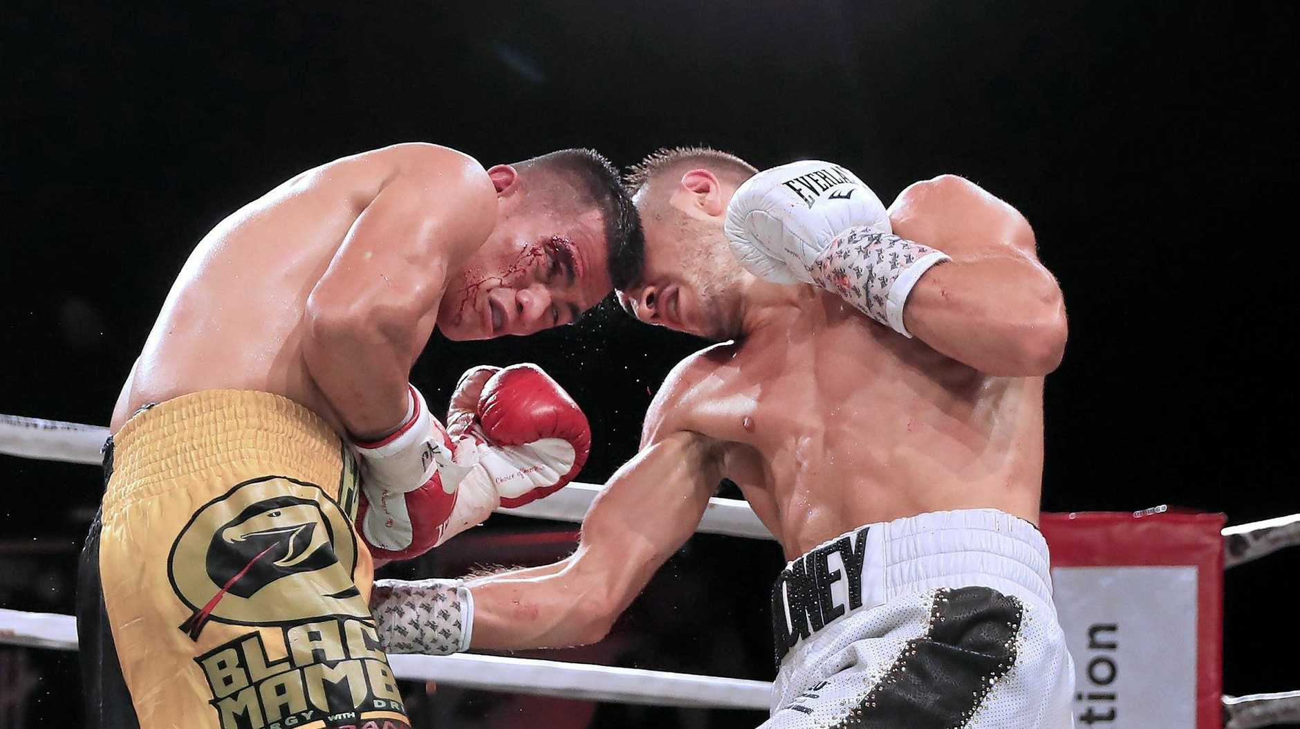 Jason Moloney (right) stopped his opponent, Cris Paulino, in the fifth round of their WBA Oceania bantamweight title bout in March.