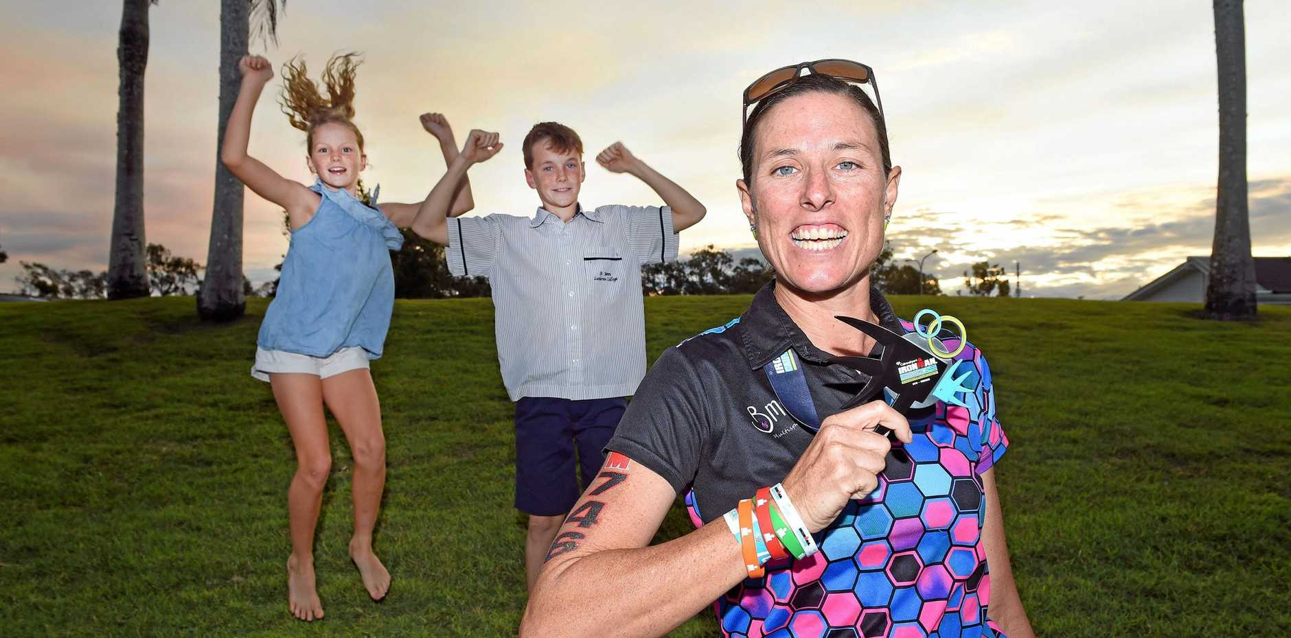 MISSION ACCOMPLISHED: Hervey Bay's Katrina Tate had the full support of her children Tilly, 10, and Link, 12, completing her first Ironwoman event in Cairns at the weekend.