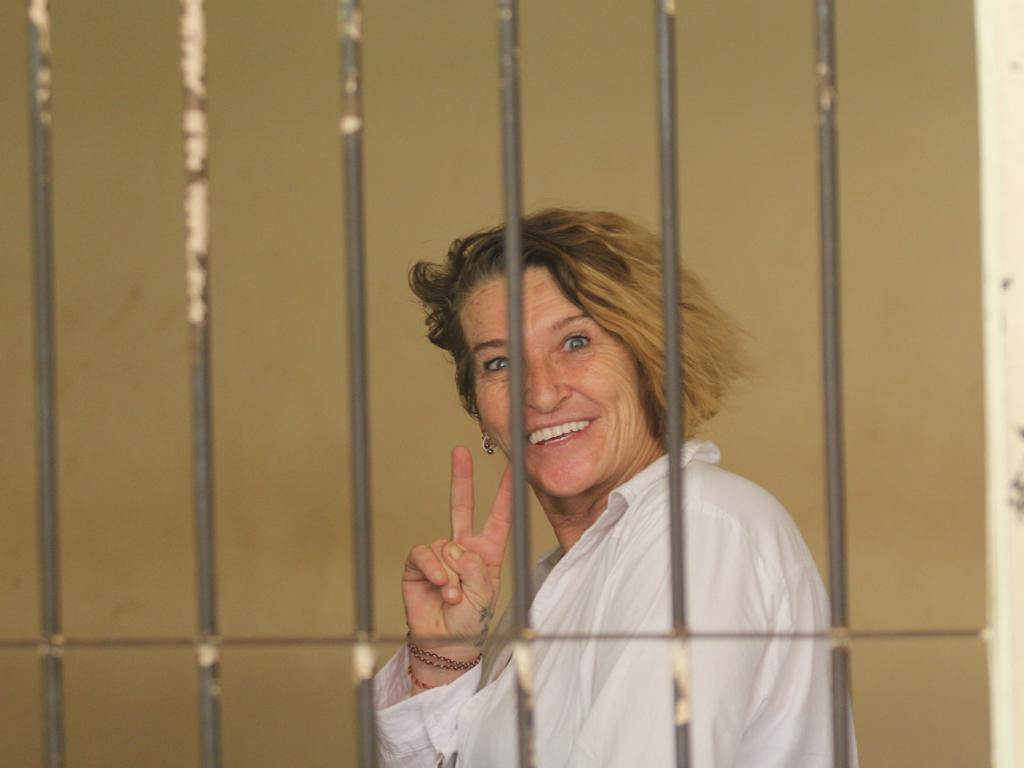 Australian designer Kim Anne Allogia flashes a peace sign at Denpasar District Court.