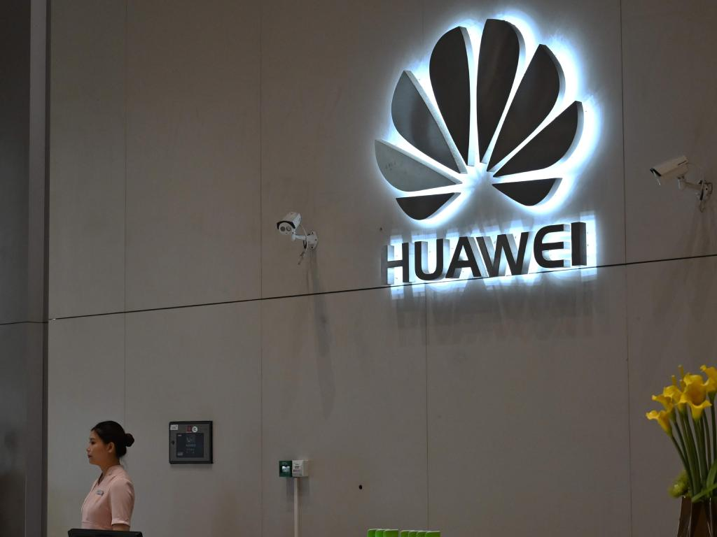 A company logo is displayed at a reception area at the Huawei headquarters in Shenzhen. Picture; Heector Retamal/AFP