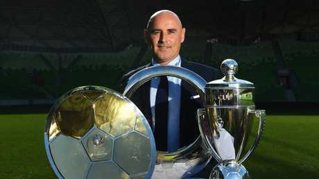 Kevin Muscat with his A-League loot. Picture: AAP