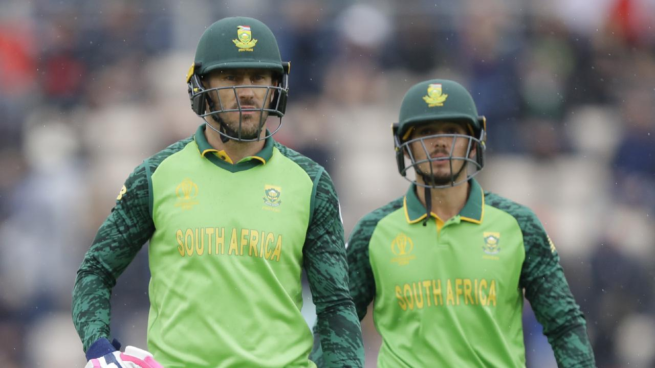 South Africa's captain Faf du Plessis, left, and South Africa's Quinton de Kock leave the pitch as rain stops play. Picture: AP Photo/Kirsty Wigglesworth