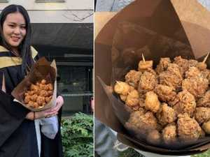 Student graduates with KFC bouquet