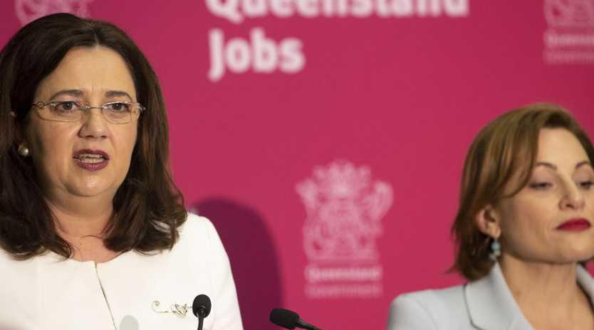 Queensland Premier Annastacia Palaszczuk and Treasurer Jackie Trad speak during the state government's 2019-20 Queensland budget media briefing in Brisbane. Picture: Glenn Hunt/AAP