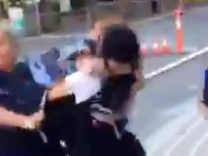 Girl, 14, charged after punching female police officer
