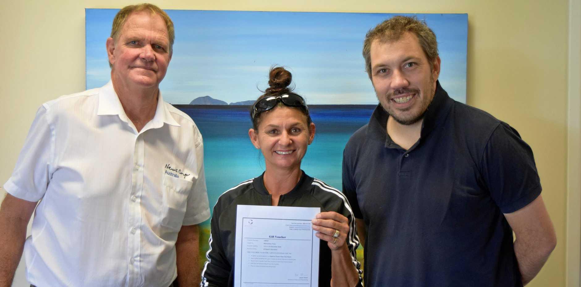 SWEET SUCCESS: Whitsundays general manager Stephen Darwen, competition winner Sara Gorman and Whitsundays regional editor Gregor Mactaggart.