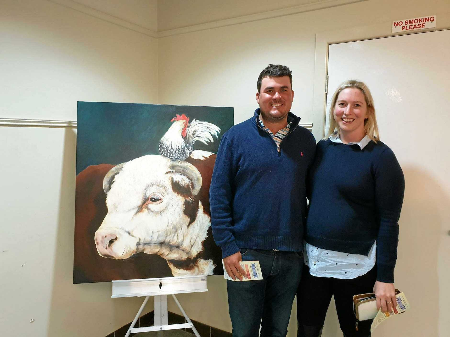 Tim and Fiona McDonald with their new painting, Brush Strokes Art Exhibition, St George 2019.