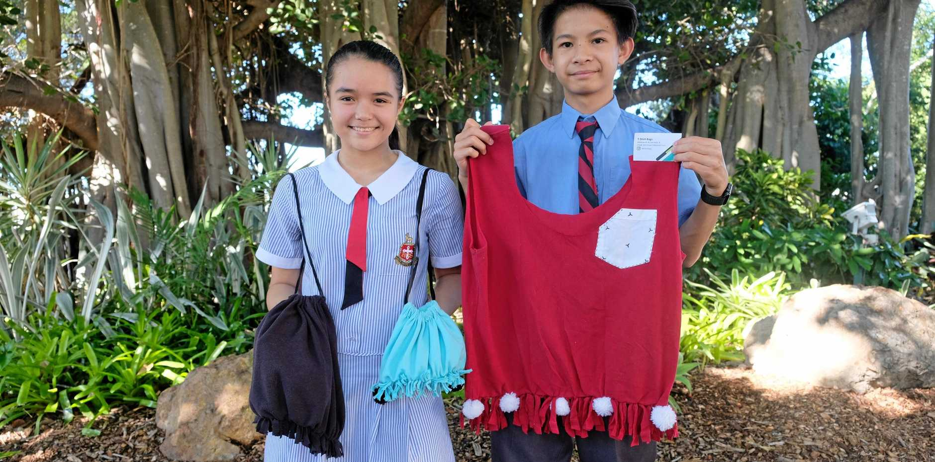 BUDDING BUSINESS OWNERS: Rockhampton Grammar School year eight students Mathew He and Samanta Rimmington have created their own business, making bags out of old t-shirts.