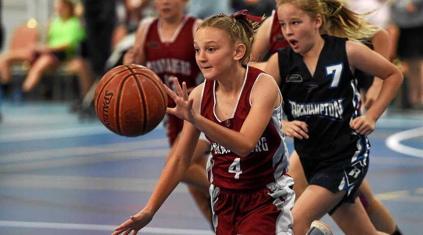Central District Basketball Carnival - Bundaberg (Maroon) v Rockhampton (Blue) - Imogen Jakeman gets in to space.