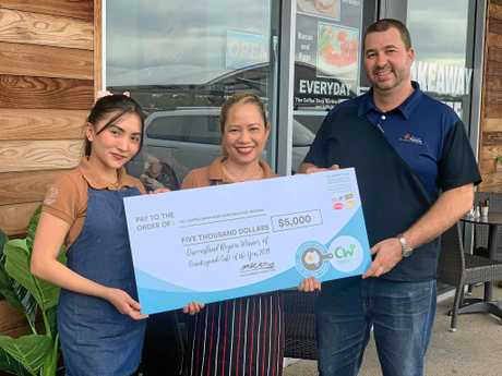 Owners of The Coffee Shop Northern Beaches Kerry Jean Corbita and Ritchie Corbita accept their prize from Whitsunday Food Service sales representative Crichton Jarred.